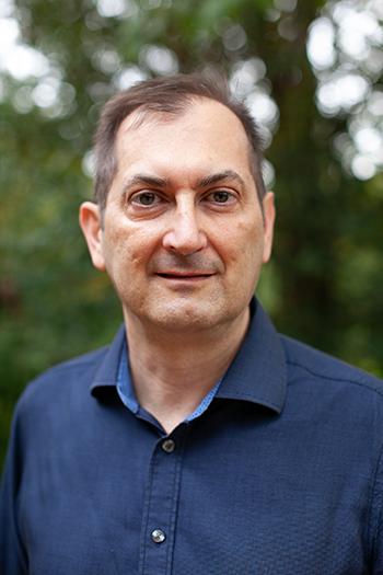 A headshot of Paul Mihas.