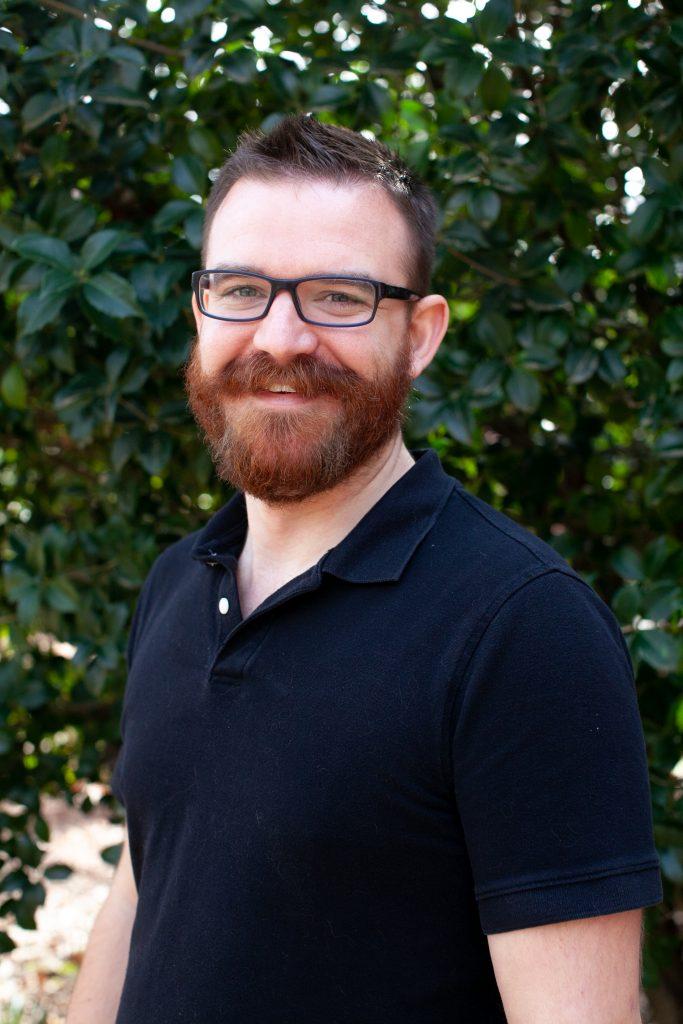 A headshot of Devin Jacob Christensen.